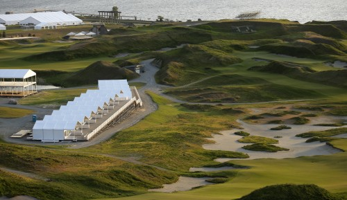 In this April 29, 2015, photo, pavilions that will be used during the U.S. Open Championship stand at the Chambers Bay golf course in University Place, Wash. Next week the course, which opened in 2007, will become the youngest golf course to host the U.S. Open since Hazeltine in 1970. (AP Photo/Ted S. Warren)
